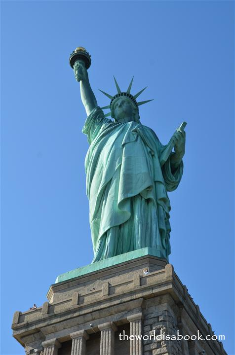 visiting the statue of liberty with kids the world is a book