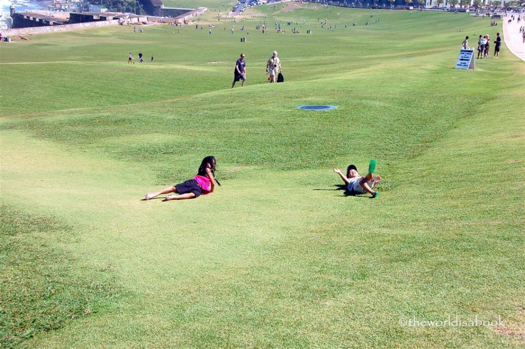 Kids Rolling in the grass at El Morro Puerto Rico