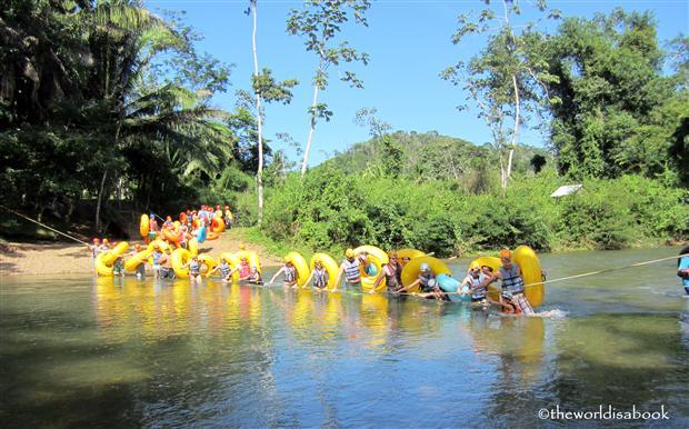 Belize cavetubing crossing the river