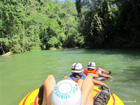 Belize cave tubing floating in river