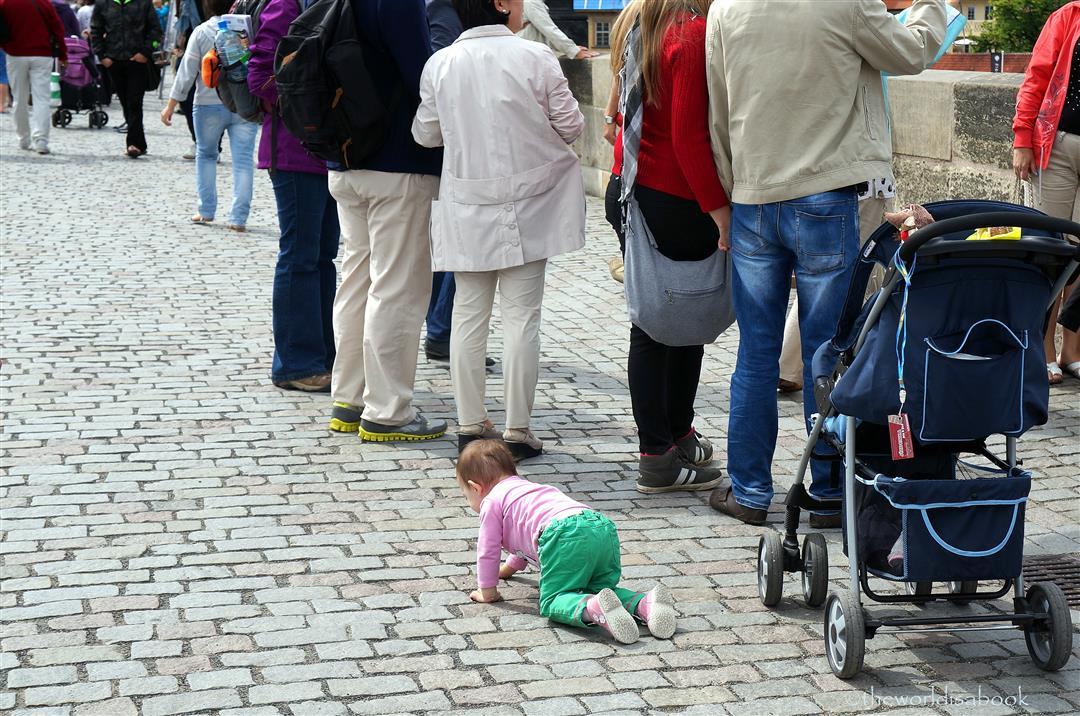 Charles Bridge baby crawling