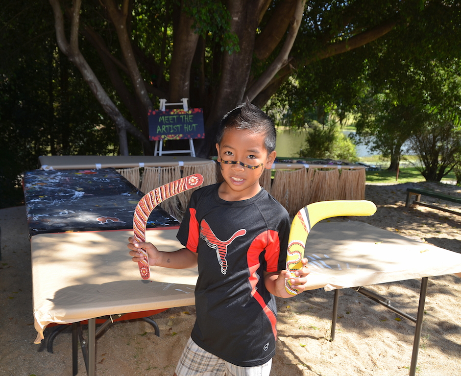 Tjapukai Aboriginal park kid with boomerangs