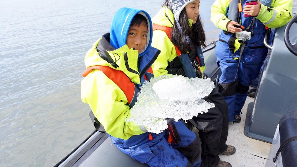 Jokulsarlon Glacier lagoon with kids ice break